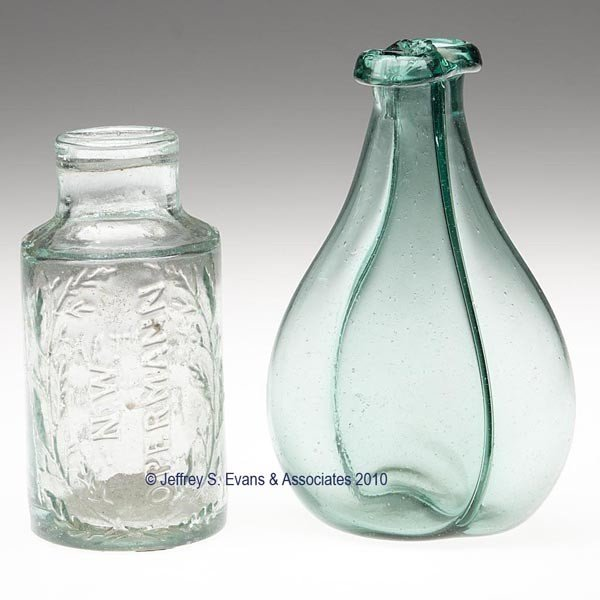 21: TWO ASSORTED BLOWN AND MOLDED BOTTLES