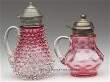 604: VICTORIAN GLASS SYRUP PITCHERS, LOT OF TWO