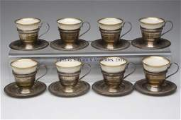669 EIGHT SETS OF STERLING SILVER AND LENOX CHINA DEMI