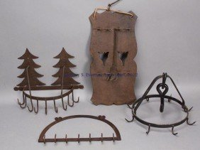 10: FOUR WROUGHT-IRON HANGING RACKS