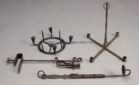 13: FOUR WROUGHT-IRON CANDLE LIGHTING DEVICES