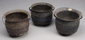 17: THREE CAST-IRON COOK POTS