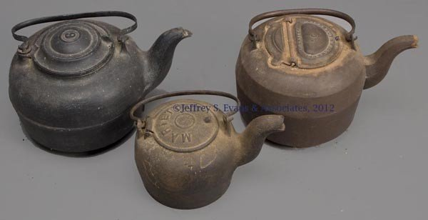 22 three castiron tea kettles