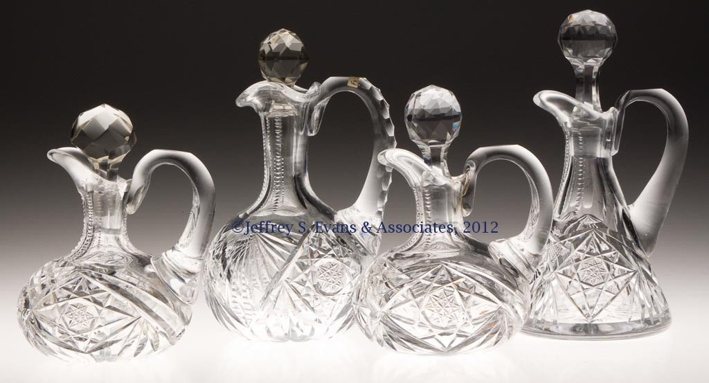 27: FRY AND OTHER CUT GLASS CRUETS, LOT OF FOUR
