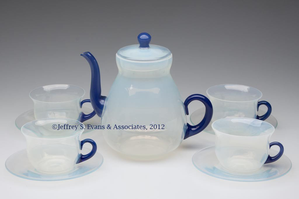 77: FRY ART GLASS TEAPOT WITH FOUR CUP AND SAUCER SETS