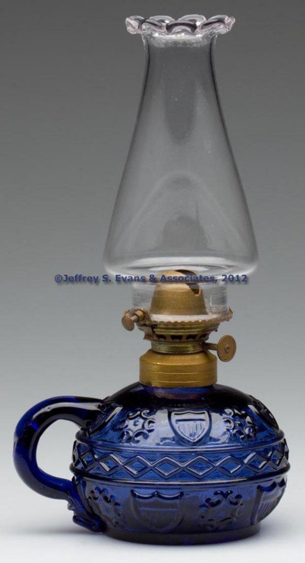 60: DIAMOND BAND AND SHIELD FINGER LAMP