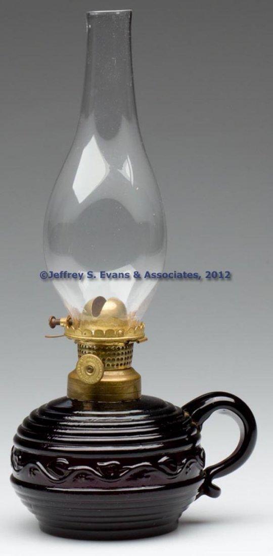 61: VINE AND RIB FINGER LAMP