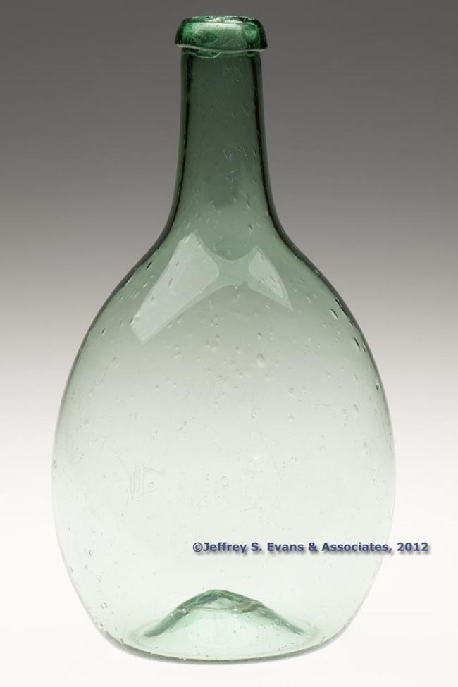 38: FREE-BLOWN CHESTNUT-FORM UTILITY BOTTLE