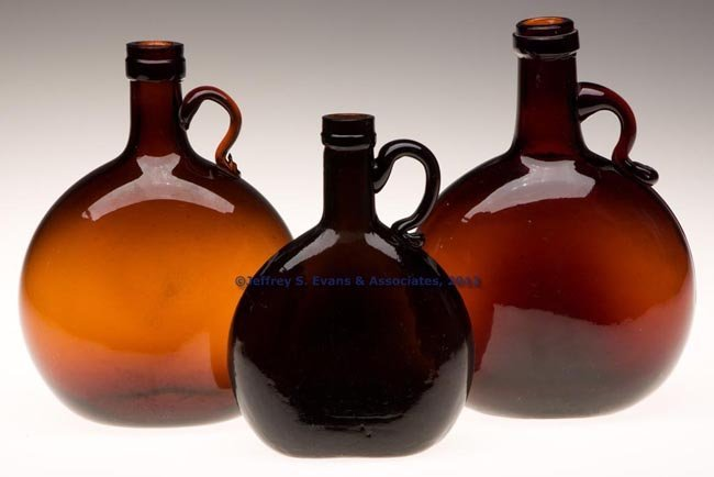 46: THREE BLOWN HANDLED CHESTNUT-FORM FLASKS
