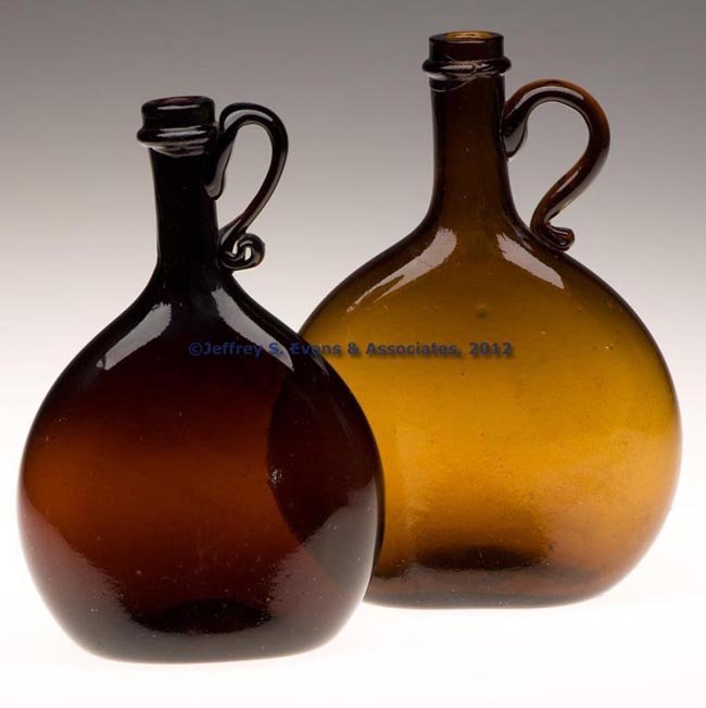 47: TWO FREE-BLOWN HANDLED CHESTNUT-FORM FLASKS