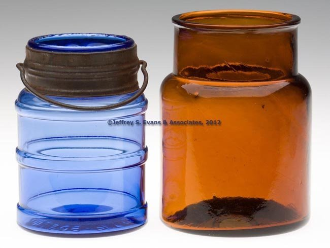 60: TWO BLOWN-MOLDED FOOD JARS