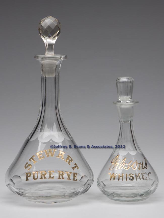 63: TWO BLOWN AND CUT WHISKEY ADVERTISING DECANTERS