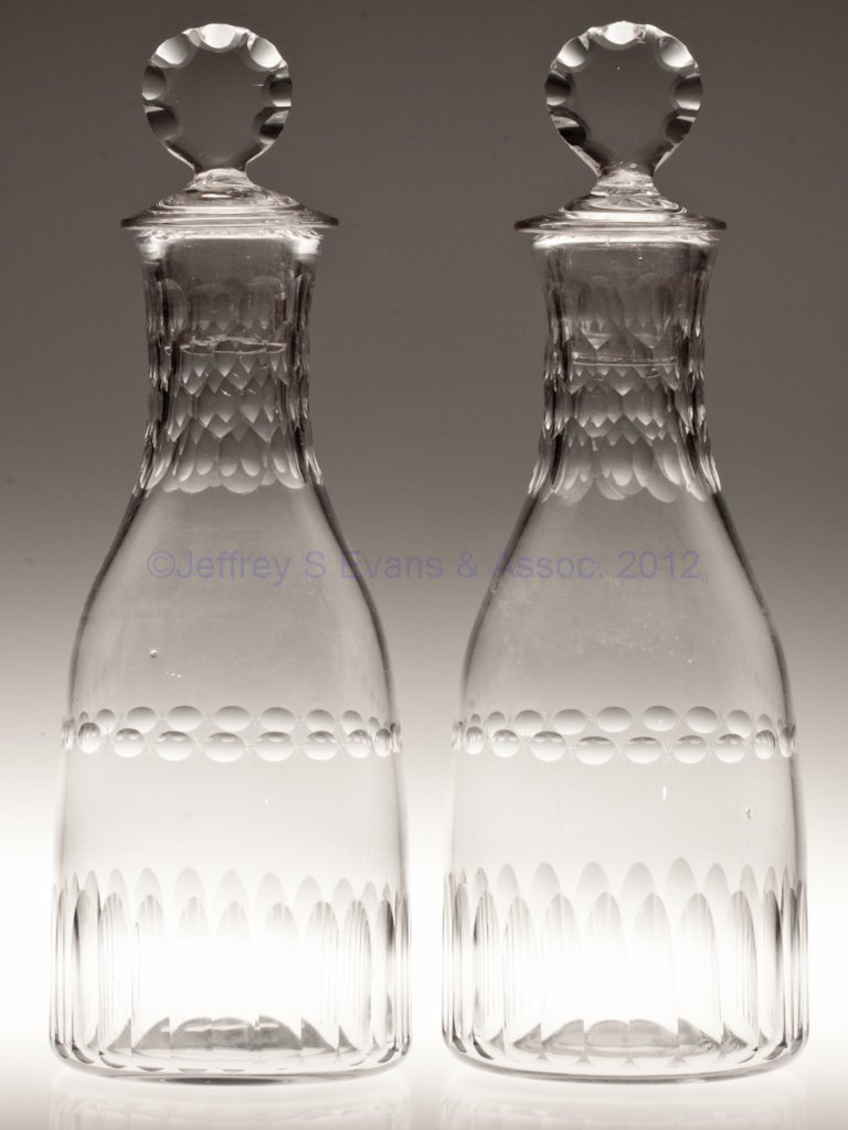 3: BLOWN AND CUT PAIR OF TAPER DECANTERS,