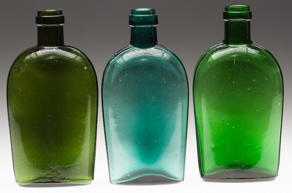 ASSORTED COLORED STRAP-SIDE FLASKS, LOT OF THREE