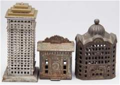 ASSORTED BUILDING CAST-IRON PENNY BANKS, LOT OF THREE