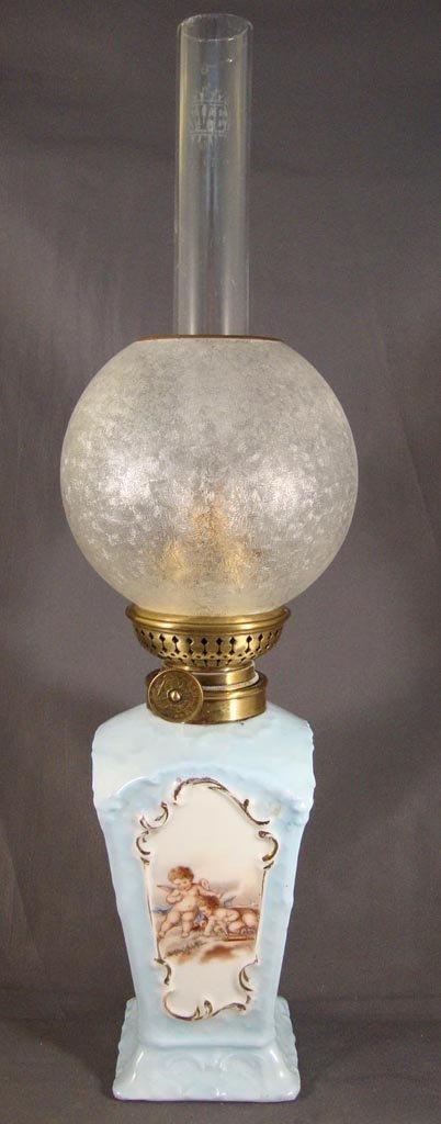 PORCELAIN CUPID DECORATED MINIATURE LAMP