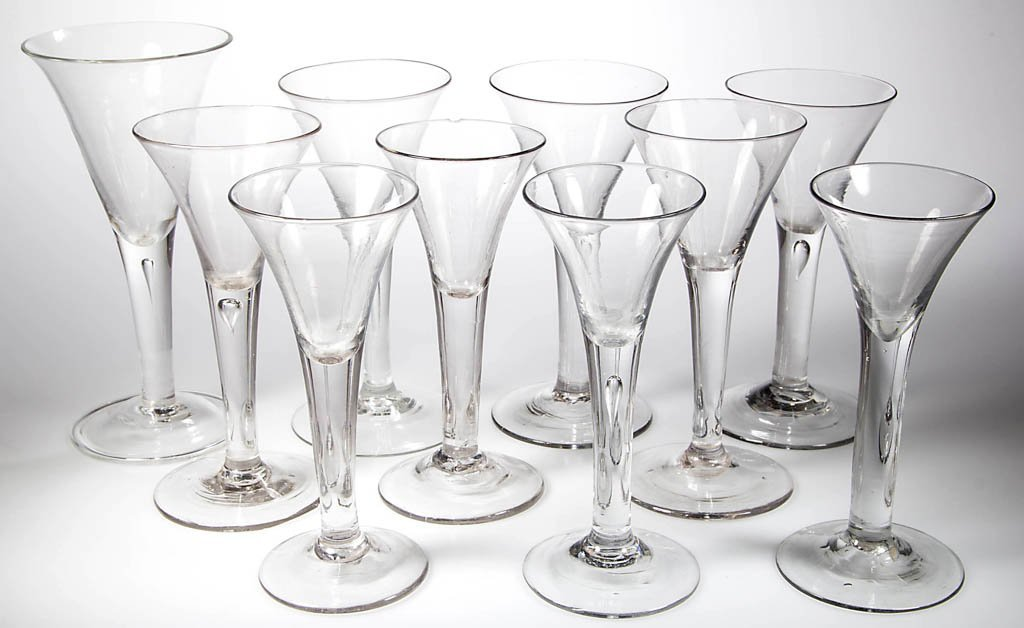 ENGLISH FREE-BLOWN WINE GLASSES, ASSEMBLED SET OF EIGHT