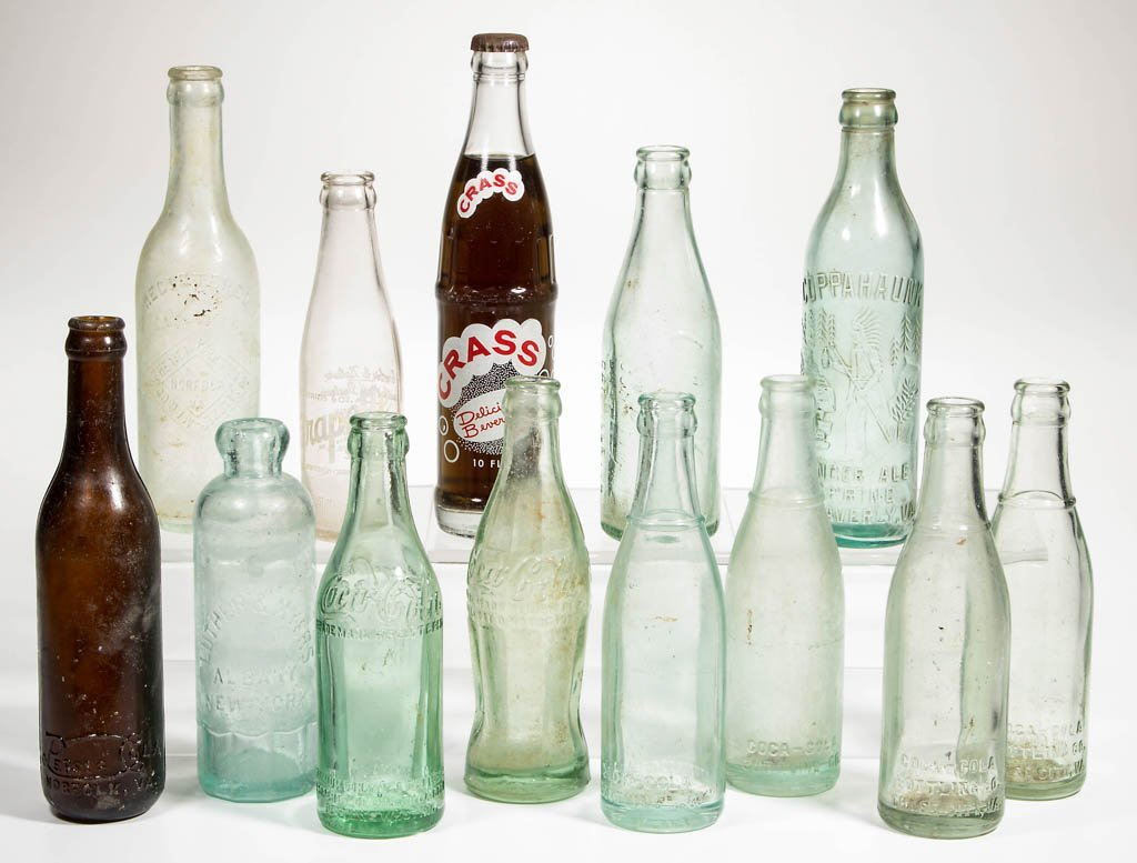 ASSORTED COCA-COLA, PEPSI-COLA, AND OTHER SODA BOTTLES,