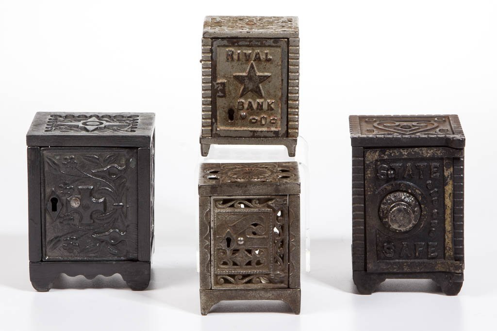 ASSORTED SAFE CAST-IRON PENNY BANKS, LOT OF FOUR