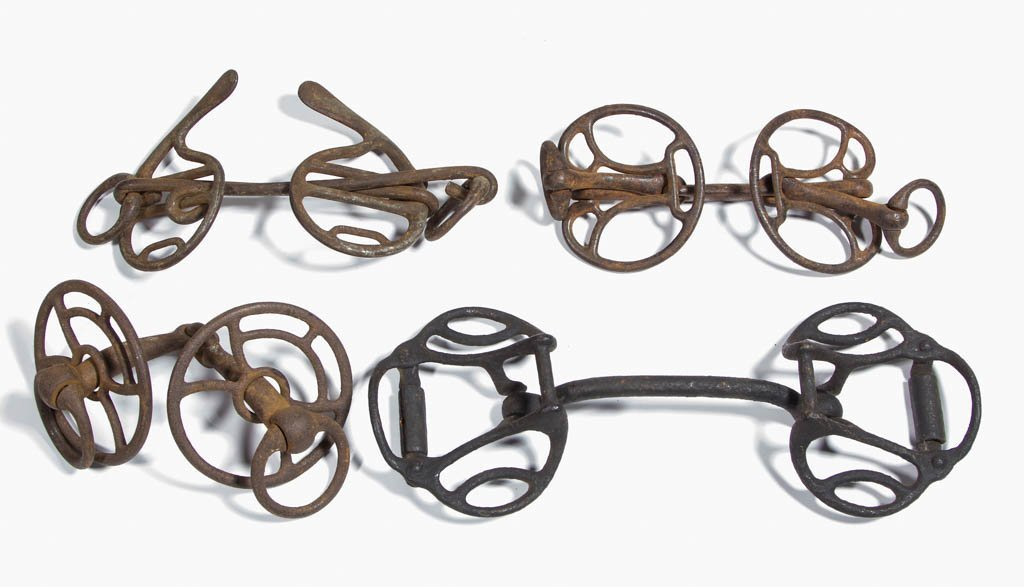ASSORTED CAST-IRON HORSE BITS, LOT OF FOUR