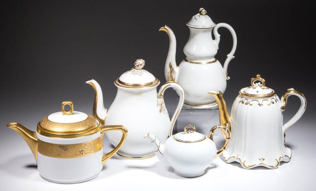 CONTINENTAL GILT-DECORATED CERAMIC TEAPOTS, LOT OF FIVE