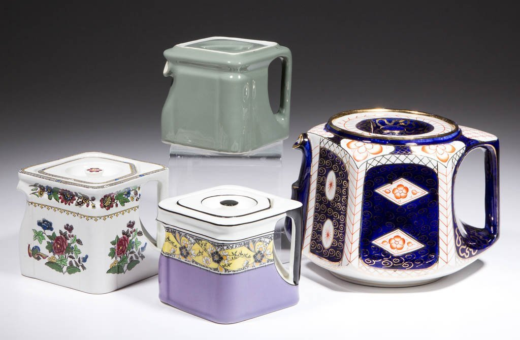 ASSORTED CUBE-SHAPED AND MOLDED CERAMIC TEAPOTS, LOT OF