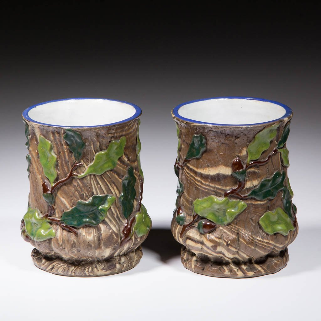 GERMAN METTLACH MOLDED PAIR OF SPILL VASES