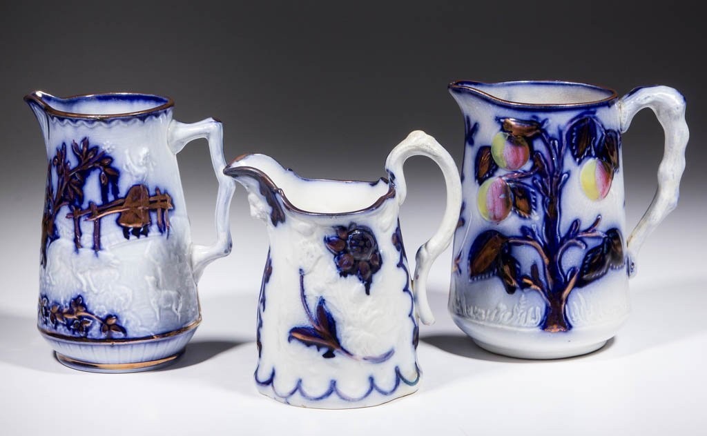 ENGLISH FLOW BLUE LUSTRE CERAMIC PITCHERS, LOT OF THREE