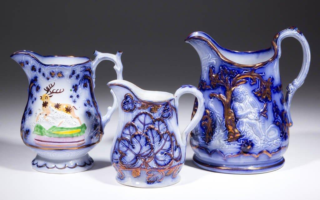 ENGLISH FLOW BLUE LUSTRE CERAMIC PITCHERS, LOT OF THREE