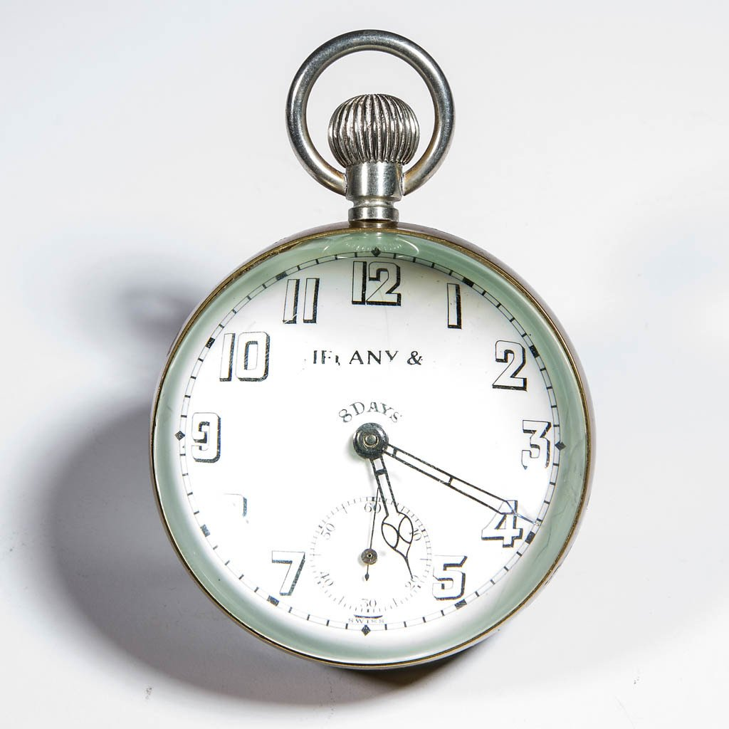 TIFFANY & CO. BRASS AND GLASS EIGHT DAY BALL CLOCK