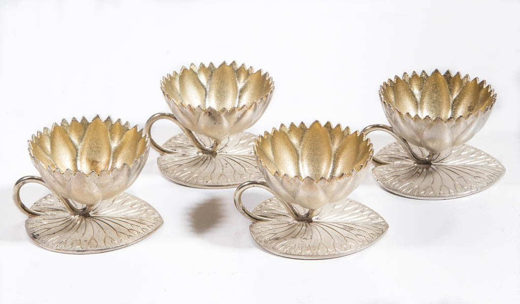 MERIDEN SILVER-PLATED FIGURAL OPEN SALTS, SET OF FOUR