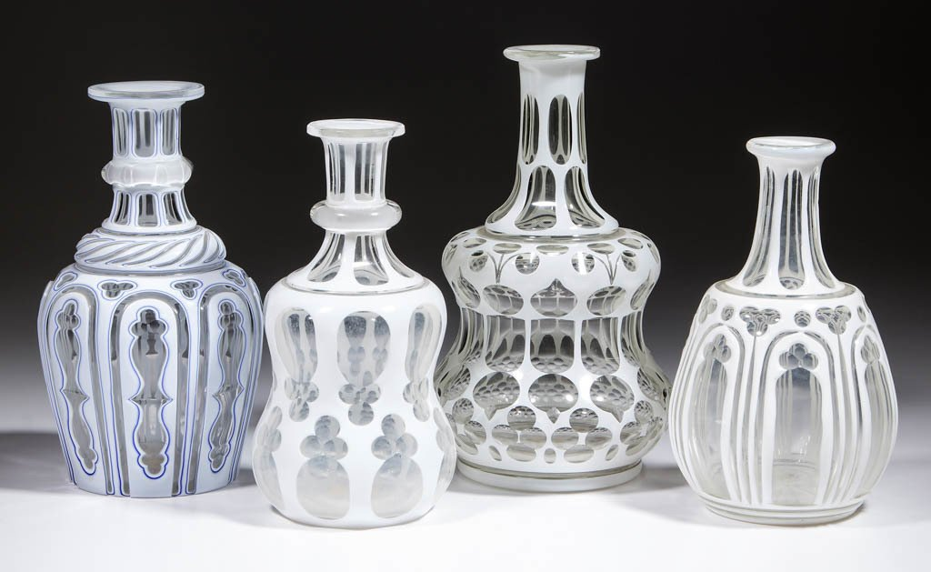 ASSORTED CUT OVERLAY DECANTERS, LOT OF FOUR