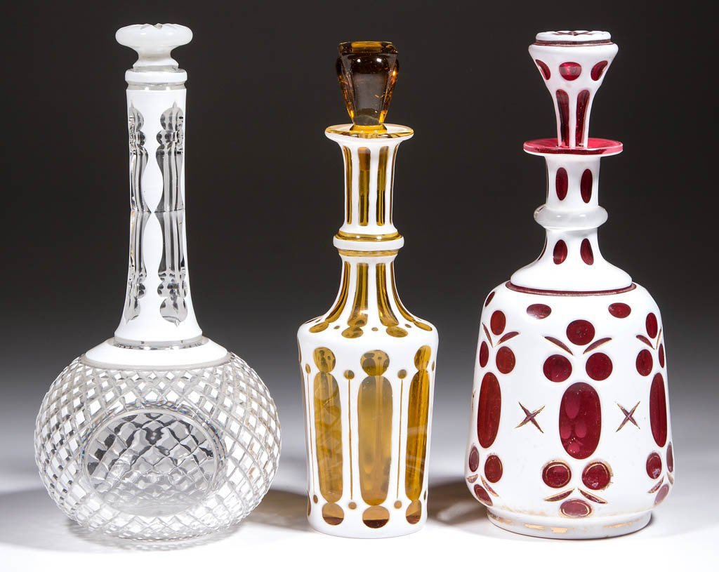 ASSORTED CUT OVERLAY DECANTERS, LOT OF THREE