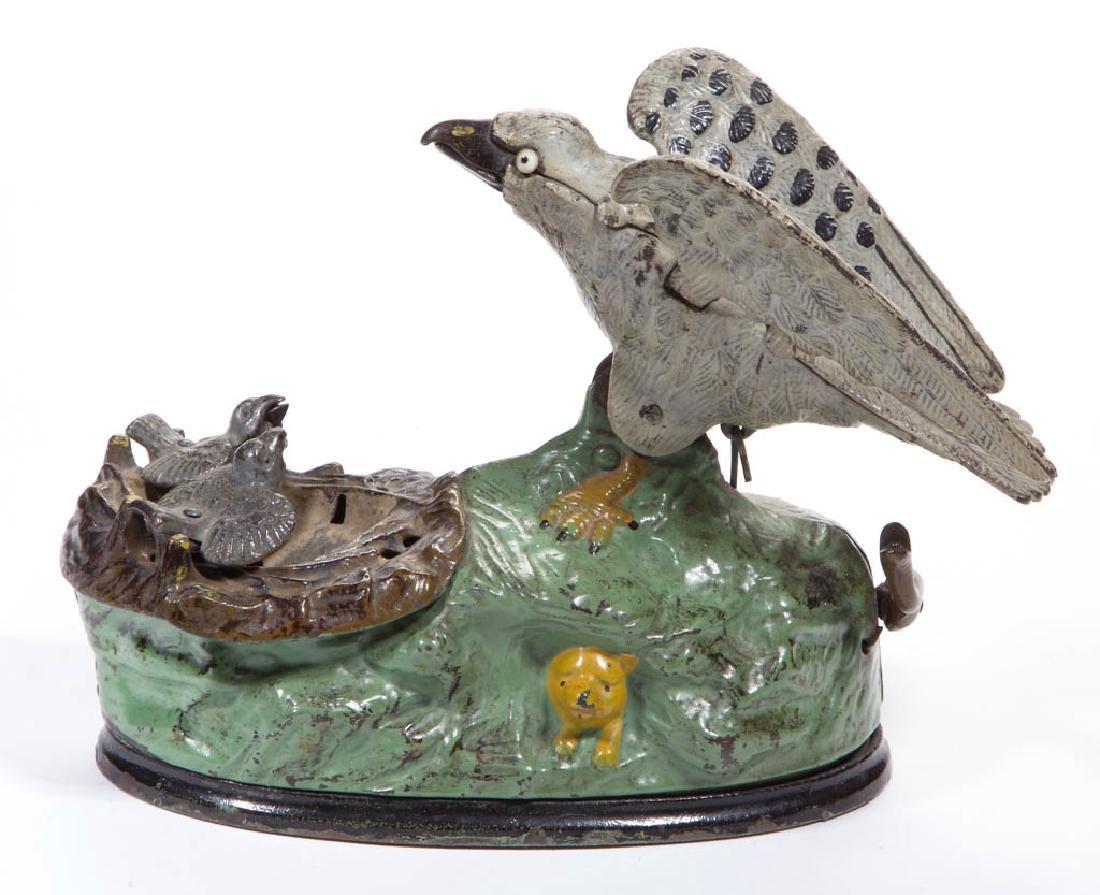 EAGLE AND EAGLETS CAST-IRON MECHANICAL BANK