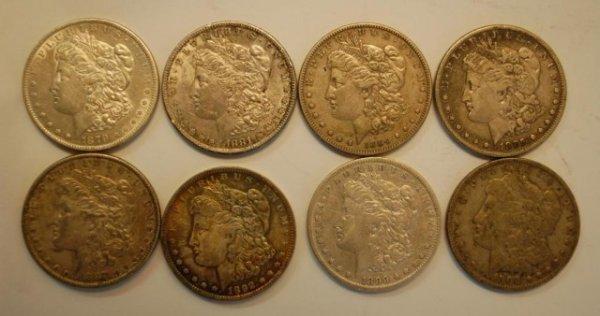 19: 8 Early Morgan US Silver Dollars