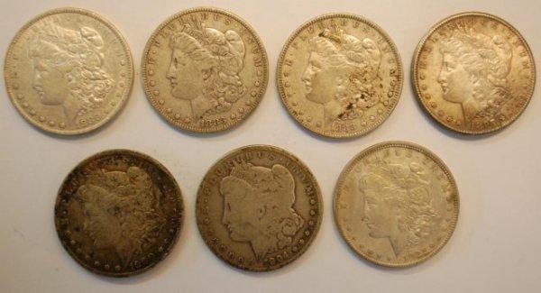 20: 7 Morgan US Silver Dollars