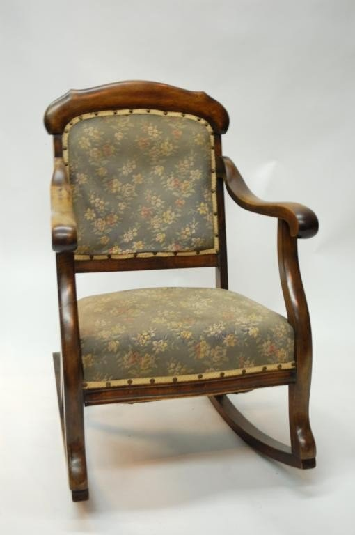 61: Antique Upholstered Rocking Chair