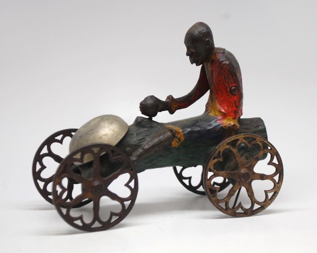 20: Cast Iron Bell Toy-Monkey w/ Coconut