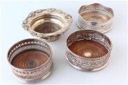 Four Silver Plate Wine Bottle Coasters,