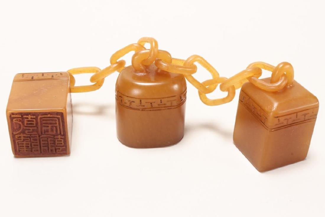 Three Chinese Yellow Hardstone Seals,