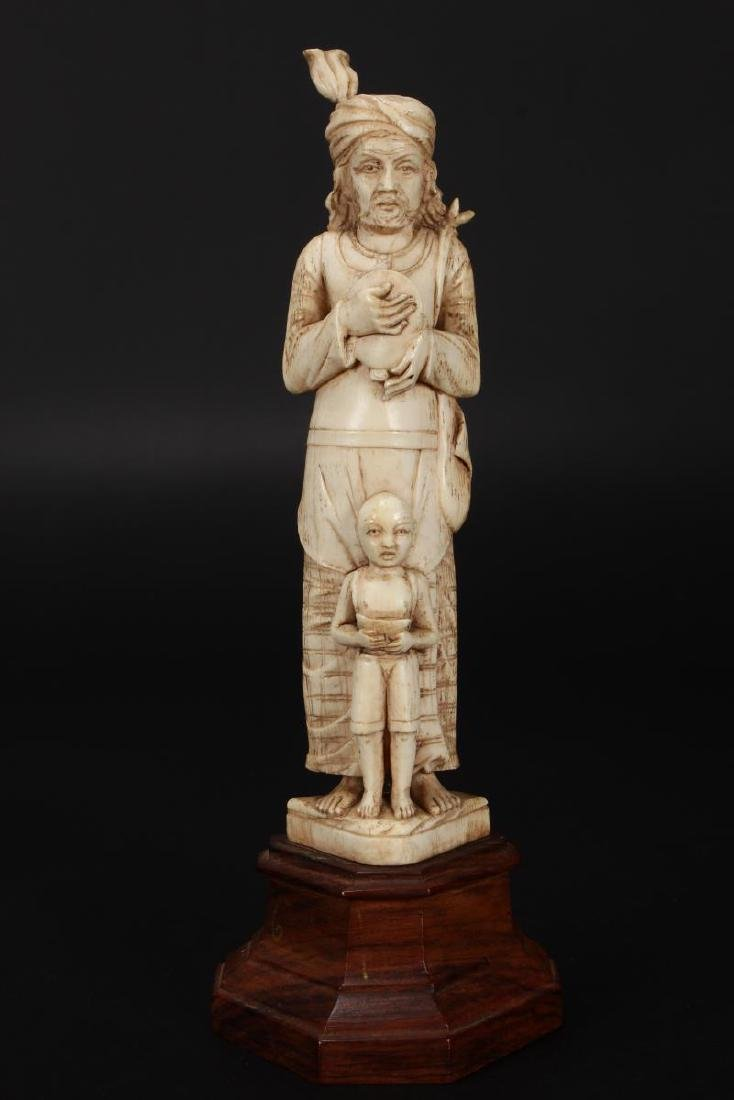 Two Indian Carved Figures,