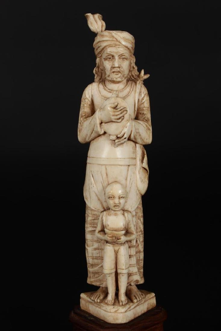 Two Indian Carved Figures, - 2