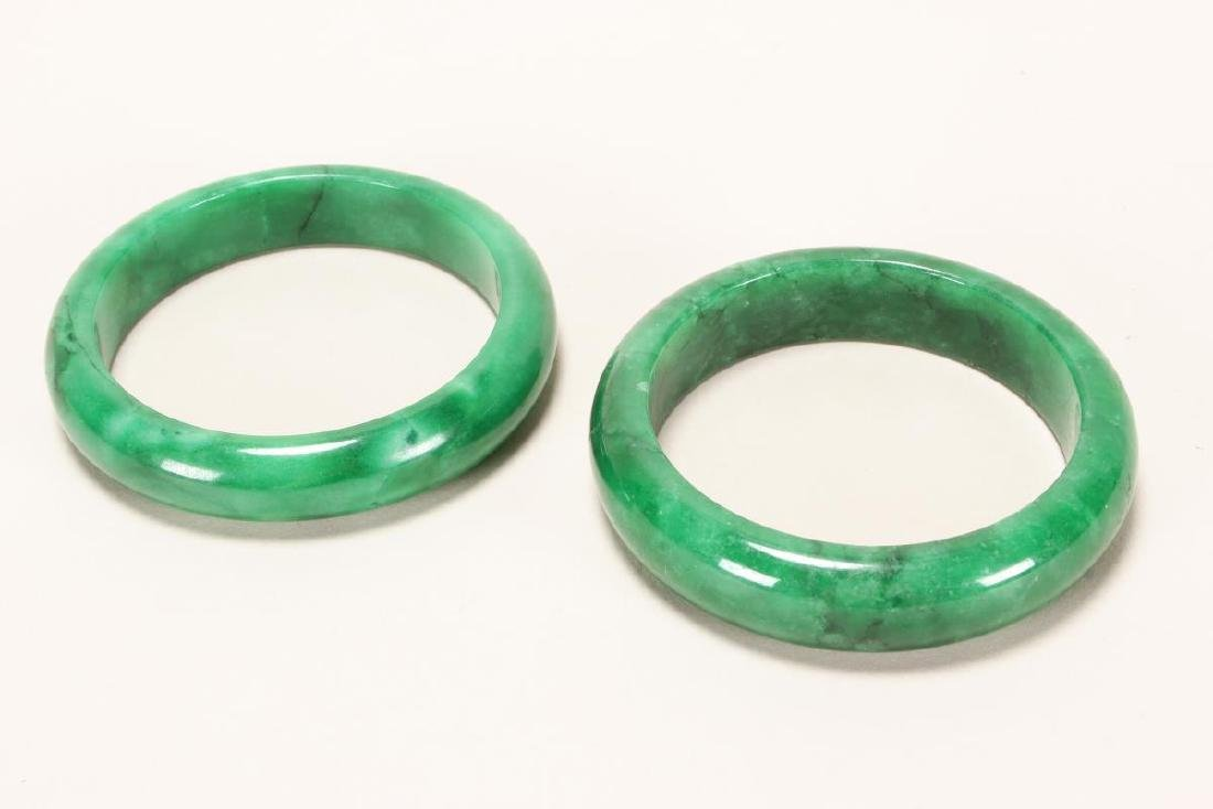 Two Chinese Green Hardstone Bangles,