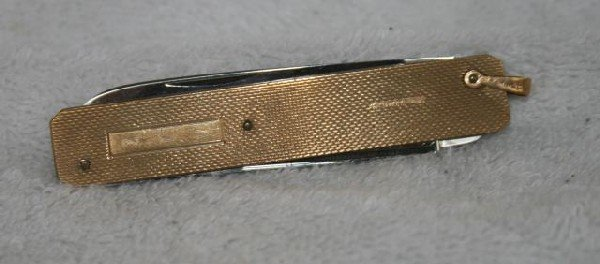 551: 9ct Gold Combination Pen Knife and Nail File,