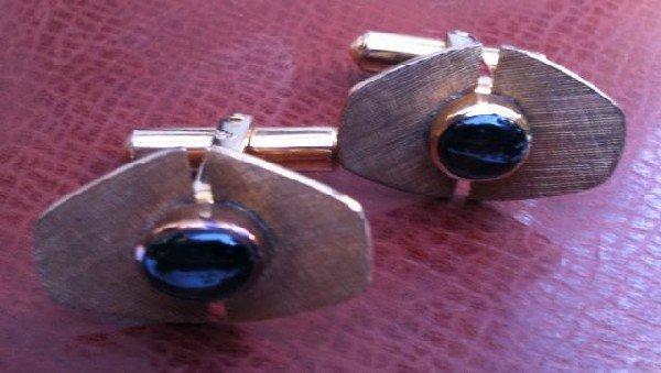 556: Pair of 14ct Gold Cufflinks,