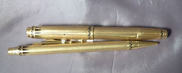 669: Two Rolled Gold and Black Enamel Pens,