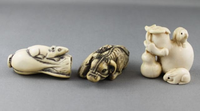 10: Three Carved and Incised Ivory Netsuke,