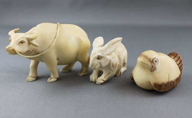 12: Three Carved and Incised Ivory Animals,