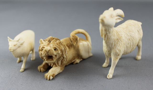14: Three Carved and Incised Ivory Animals,