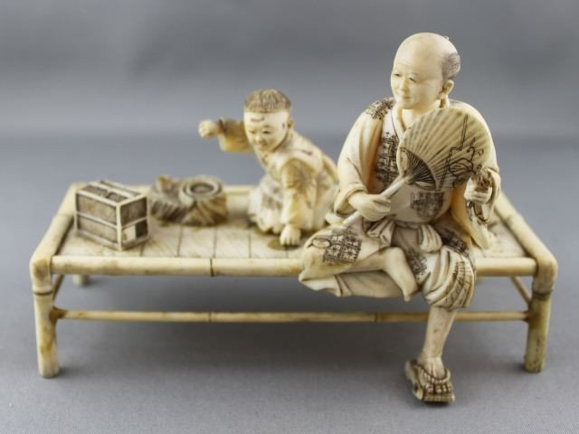 17: Carved Ivory Figure Group,